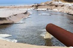 Stock, sea, pipe, draining, ecology, sanitation, pollution. Stock sea pipe draining ecology sanitation pollution Royalty Free Stock Image