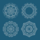 Stock set circular pattern looped flowers blue background.  royalty free illustration