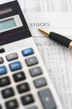 Stock, share market table analysis. Stock market table analysis, calculator and pen indicates research and analysis, vertical orientation, pen pointing to word stock photos