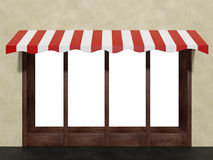 Stock shop boutique store front window with awning Royalty Free Stock Photography