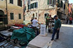 Stock for shops being unloaded in Venice canal stock photo