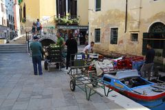 Stock for shops being unloaded in Venice canal royalty free stock photography