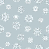 Stock snowflake vector seamless pattern on a blue background Stock Photos