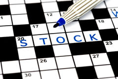 Stock in solving crossword puzzle Stock Photography