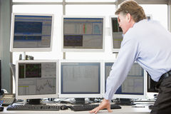 Stock Trader Examining Computer Monitors Stock Images