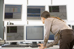 Stock Trader Examining Computer Monitors Royalty Free Stock Images