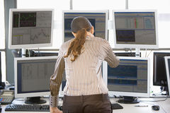 Stock Trader Looking At Multiple Monitors Royalty Free Stock Photo
