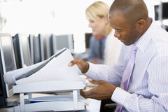 Stock Trader Looking Though Paperwork Royalty Free Stock Image