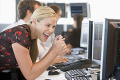 Stock Trader Overjoyed Looking At Monitor Royalty Free Stock Images