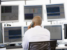 Stock Trader On The Phone. At work stock image