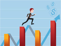 Stock trader running on the financial stock bar charts. A businessman, who is running on the financial stock bar charts, nearly reaches his goal Royalty Free Stock Photo