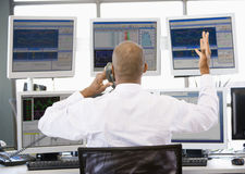 Stock Trader Talking Animatedly On The Phone Stock Photos