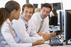 Stock Trader Team At Work Royalty Free Stock Image