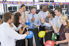 Stock Traders Celebrating In The Office. Toasting A Colleague Royalty Free Stock Images