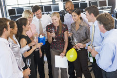 Stock Traders Celebrating In The Office. Standing In A Group Drinking Stock Image