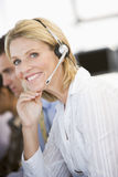 Stock Traders With Headsets At Work Royalty Free Stock Photos