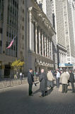 Stock traders take a break in front of the New York Stock Exchange on Wall Street, New York City, New York Royalty Free Stock Image