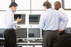 Stock Traders Viewing Monitors. At work Royalty Free Stock Image