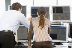 Stock Traders Viewing Monitors. Together Royalty Free Stock Image