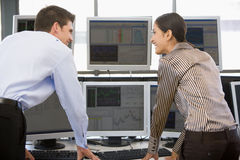 Stock Traders Viewing Monitors. Together Royalty Free Stock Images