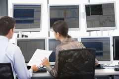 Stock Traders Viewing Monitors. Together Stock Photos