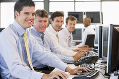 Stock Traders At Work. Smiling Royalty Free Stock Images