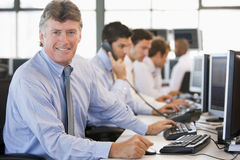 Stock Traders At Work. Smiling At Camera Royalty Free Stock Photo