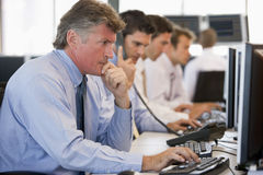 Stock Traders At Work. Focused And Serious Royalty Free Stock Photography