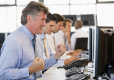 Stock Traders At Work. Celebrating Royalty Free Stock Image