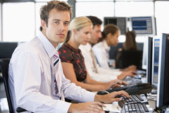 Stock Traders Working At Computers. In day Stock Image