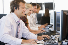 Stock Traders Working At Computers Royalty Free Stock Photos
