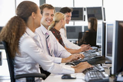 Stock Traders Working At Computers Royalty Free Stock Images