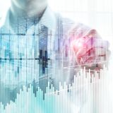 Stock trading candlestick chart and diagrams on blurred office center background stock photography