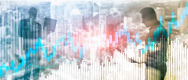 Stock trading candlestick chart and diagrams on blurred office center background. Stock trading candlestick chart and diagrams on blurred office center royalty free stock photo