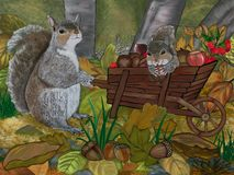 Stock up for Winter. Mum squirrel  stockpiles food for the coming winter while his baby is Royalty Free Stock Images