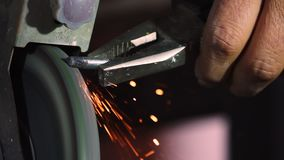 Sparks from metal grinder. This stock video features sparks flying off a metal bolt as it is being grinded down stock video