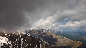Stock Video Footage Alpine Flying under clouds stock footage