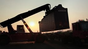 Stock Video Footage 1920x1080 Cargo Cart Trolley Truck Carriage Bogie Dolly Delivery. Truck runs at sunset, there are ranks containers. The development of trade stock video