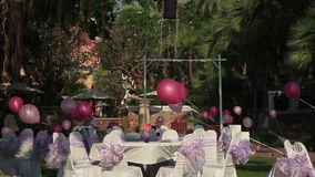 Stock Video Footage 1920x1080 The eve of Valentines Day, celebration on open-air restaurant in the hotel. Panorama. Preparing for the day of St. Valentina, Asian stock video