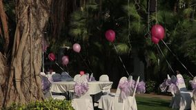 Stock Video Footage 1920x1080 The eve of Valentines Day, celebration on open-air restaurant in the hotel. Preparing for the day of St. Valentina, Asian stock video