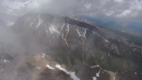 Stock Video Footage Flying over the icy mountain peak stock video footage