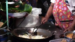 Stock Video Footage hdv Cooking Thai food outdoors, fried boiling oil, pies stock video footage