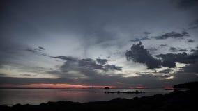Stock Video Footage 4K pink stripe horizon sunset lake island timelapse Stock Image