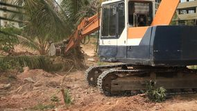 Stock Video Footage 1920x1080 Excavator on a construction site equates land clearing a building site, excavator bucket working. stock footage