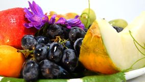 Composition from Fruit Berry. This is a stock video Presented close-up of vegetables and fruits rotating full circle. The clip was recorded on a white background stock video
