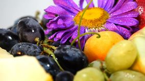 Composition from Fruit Berry. This is a stock video Presented close-up of vegetables and fruits rotating full circle. The clip was recorded on a white background stock footage