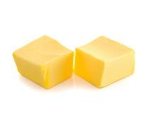 Stock von Butter auf weißem Hintergrund Stockfotografie