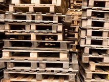 Stock of wooden euro pallets at transportation company. Wooden shipping pallets with sky background Stock Photos