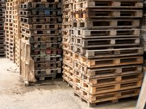 Stock of wooden euro pallets at transportation company. Wooden shipping pallets with sky background Royalty Free Stock Photo