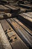 Stock of wooden sleepers. Warehouse with stocked wooden railway sleepers Royalty Free Stock Image